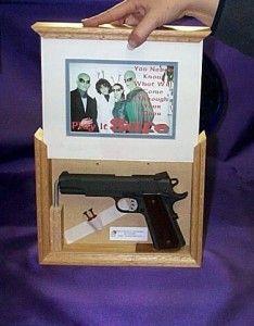 hidden gun in picture frame