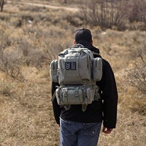 man with military backpack