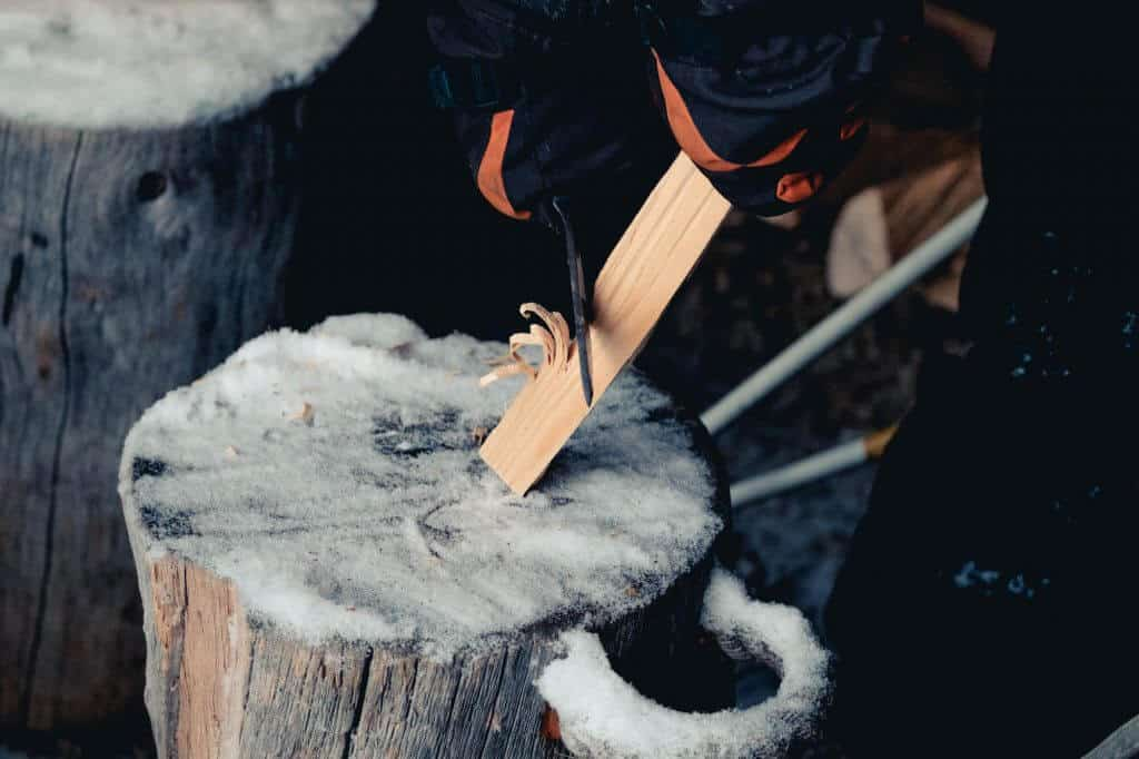 feathering stick with knife