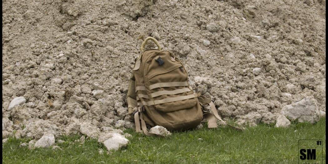 tactical backpack on ground