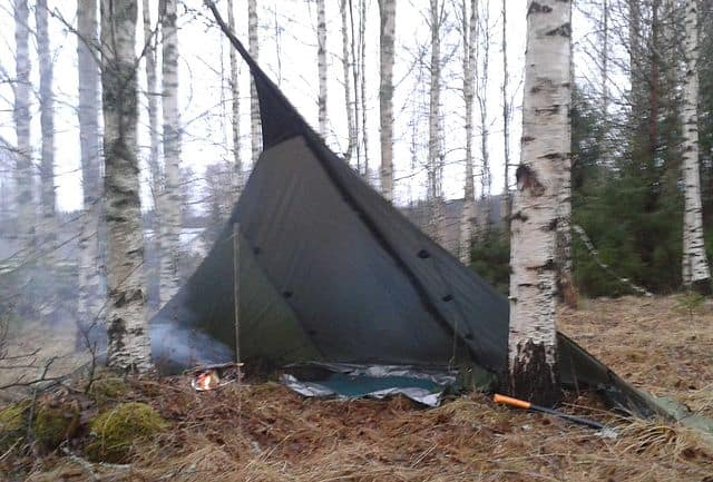 Campfire Protected from Rain by Tarp