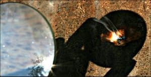 Starting a fire with a magnifying glass
