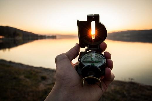Lensatic compass follow course landmark