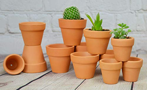 Terra cotta clay flower pot unglazed with candle emergency room heater