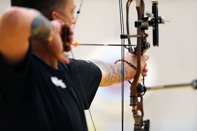 How to hold a compound bow grip nock the arrow on the string